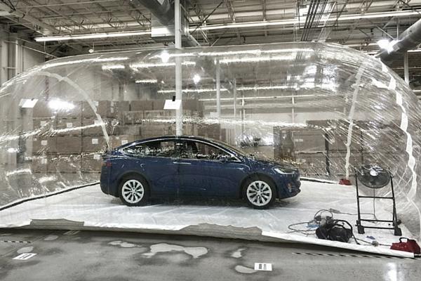 Tesla Model X inside pollution bubble