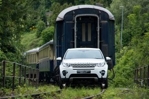 Land Rover Discovery Sport towing a train